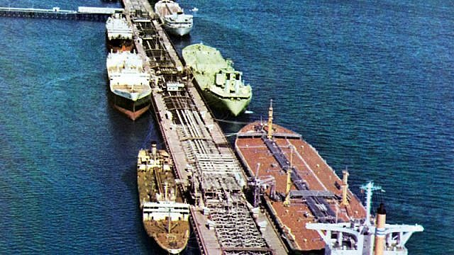 Large tankers loading at Kharg Island Terminal, offshore in the Persian Gulf. As of 2012, the terminal has handled about 98 percent of Iran's crude exports. Credit: National Iranian Oil Company via Wikimedia Commons.