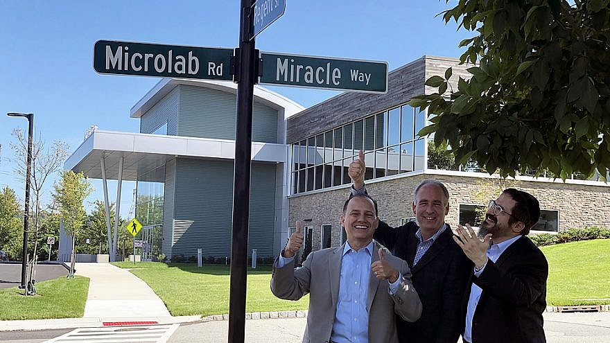 """From left: Mayor of Livingston, N.J., Alfred Anthony, and former mayor and current Town Council member Ed Meinhardt join CEO of LifeTown Rabbi Zalman Grossbaum in welcoming the new """"Miracle Way"""" street sign in Esssex County, N.J. on Aug. 29, 2019. Credit: Courtesy."""