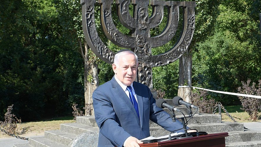 Israeli Prime Minister Benjamin Netanyahu delivers a speech on Aug. 19, 2019 at a ceremony in memory of Ukrainian Jews who were murdered at Babi Yar during World War II. Photo by Amos Ben-Gershom/GPO.