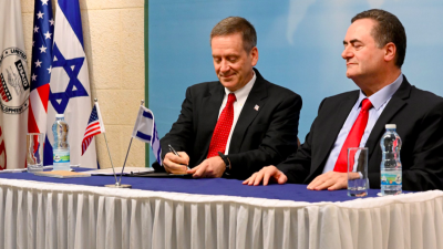 U.S. Agency for International Development administrator Mark Green signs a Memorandum of Understanding (MOU) with Israeli Foreign Minister Israel Katz in Jerusalem on Aug. 21, 2019. Credit: Screenshot via Mark Green/Twitter.