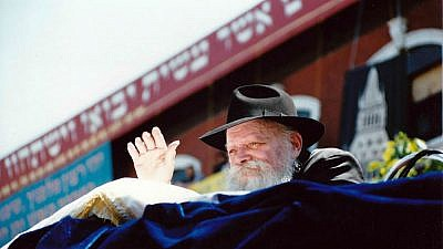 The Lubavitcher Rebbe, Rabbi Menachem Mendel Schneerson, waves to children at a Lag B'Omer parade in the Crown Heights neighborhood of Brooklyn, N.Y., on May 17, 1987. Credit: Mordecai Baron via Wikimedia Commons.