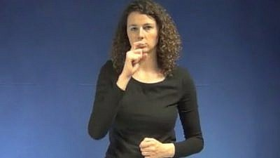"A screenshot of Flemish sign language for using a hooked nose to describe the word ""Jew."" Credit: Screenshot."