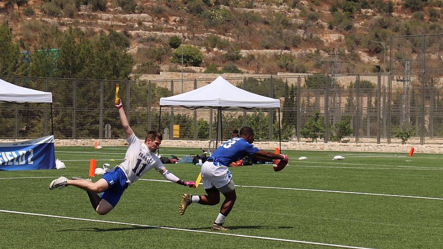 A member of the Israeli team goes for the flag. Photo by Shannon Nuszen.