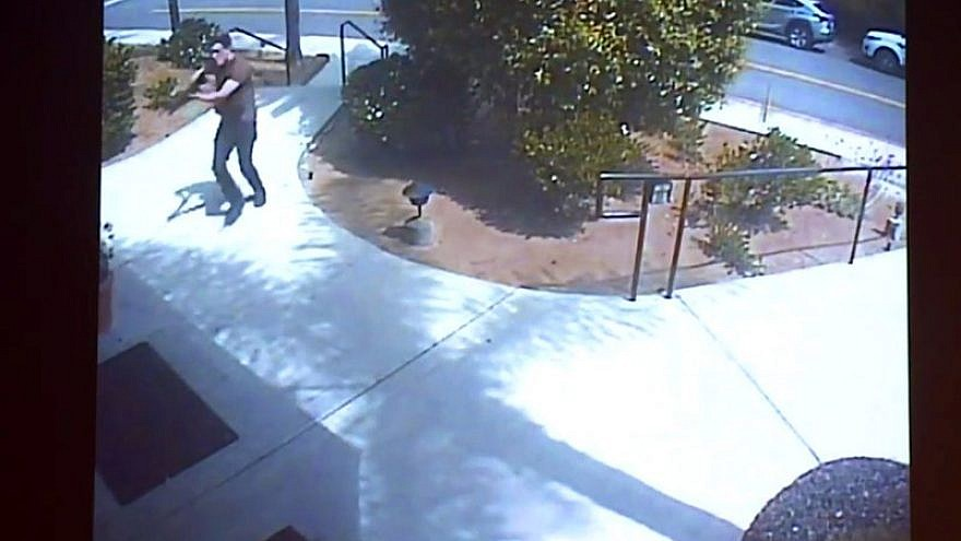 Surveillance footage at the Chabad of Poway, Calif., shown as evidence in the preliminary hearing of John Earnest on Sept. 19, 2019, showing the suspect starting his shooting spree on April 27, 2019. A woman was killed and three others were injured. Credit: Chabad of Poway via San Diego Superior Court.