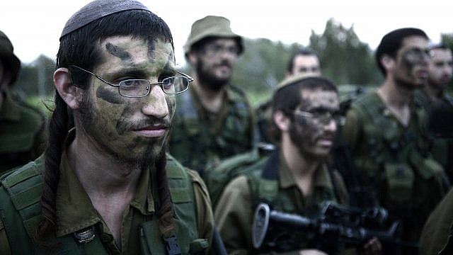 """Israeli soldiers in the Neztah Yehuda (""""Nahal Haredi"""") Battalion complete the final stages of a 40-kilometer march, Feb. 16, 2010. Photo by Abir Sultan/Flash90."""