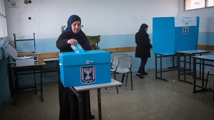 Israeli Arabs cast their votes at a polling station in the Arab town of Beit Safafa on March 17, 2015, in the Israeli general elections for the 20th parliament. They came out in greater numbers for the Sept. 17 second election and had a direct effect on the results. Photo by Miriam Alster/Flash90.
