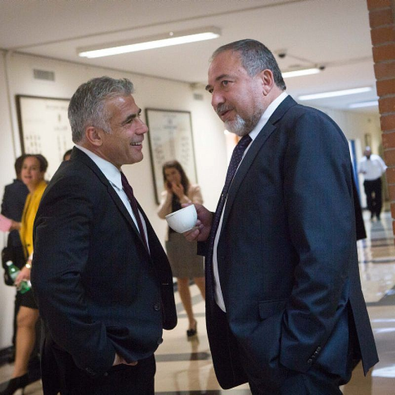 Leader of Yisrael Beiteinu party Avigdor Lieberman (R) speaks with Yesh Atid party leader Yair Lapid in the corridors of the Israeli parliament on November 16, 2015. Photo by Miriam Alsterl/Flash90.