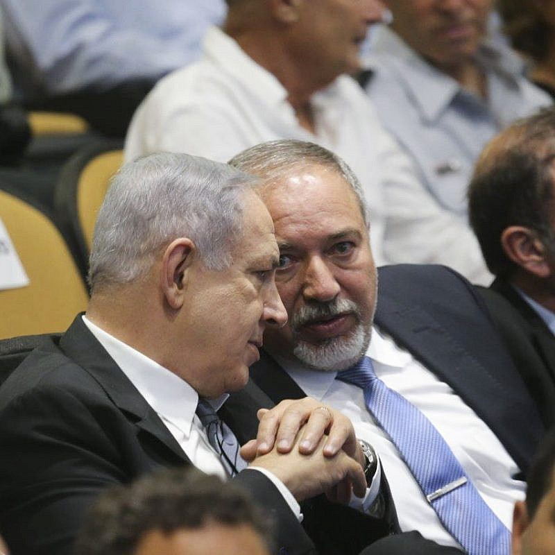 Israeli prime minister Benjamin Netanyahu and Defense Minister Avigdor Lieberman attend the graduation ceremony at the National Security College on July 13, 2016. Photo by FLASH90