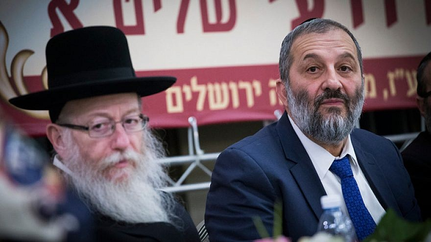 UTJ Party head Yaakov Litzman (left) and Shas Party leader Aryeh Deri attend a conference at the Ramada Jerusalem Hotel on Feb. 16, 2017. Photo by Yonatan Sindel/Flash90.