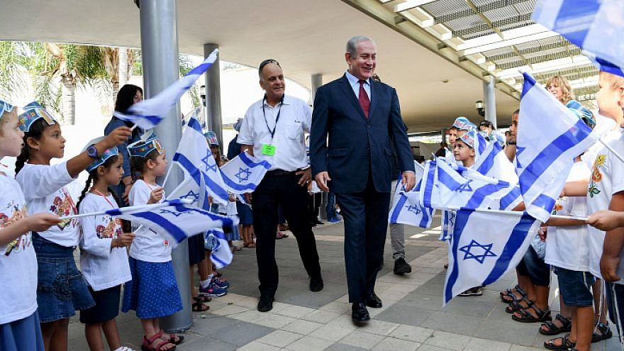 Israeli Prime Minister Benjamin Netanyahu visits Israeli children on the first day of the school year in Yad Binyamin on Sept. 2, 2018. Photo by Avi Ohayon/GPO.