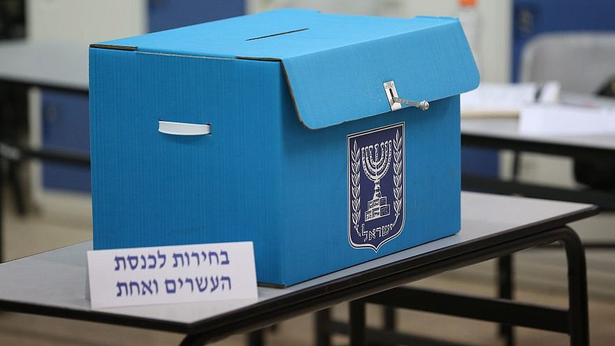 Israeli citizens cast their ballots at a voting station during the Knesset elections on April 9, 2019. Photo by David Cohen/Flash90.
