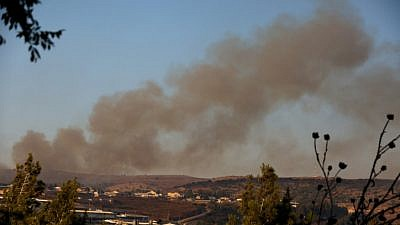 Smoke rises from a fire caused from a rocket fired from Lebanon by Hezbollah, near Moshav Avivim in northern Israel, Sept. 1, 2019. Photo by David Cohen/Flash90.