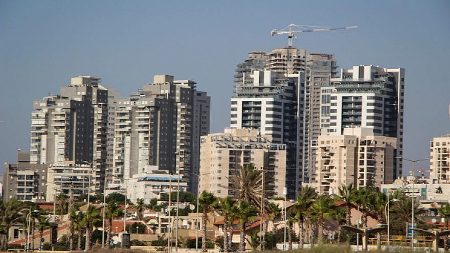 A view of new high-rise apartment buildings next to older small homes in the southern Israeli city of Ashdod on Sept. 2, 2019. Photo by Gershon Elinson/Flash90.