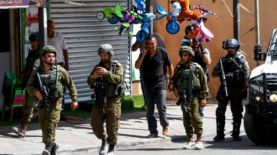 Israeli security forces near the scene of a stabbing attack in the village of Azun, near the city of Qalqilya, on Sept. 7, 2019. Photo by Nasser Ishtayeh/Flash90.