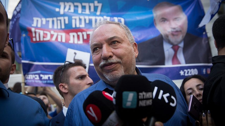 Yisrael Beiteinu Party leader Avigdor Lieberman speaks to press while touring the Sarona Market in Tel Aviv during the second round of Israeli elections on Sept. 17, 2019. Photo by Miriam Alster/Flash90.