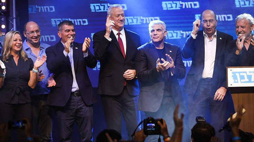 Blue and White Party chairman Benny Gantz with party members at campaign headquarters on election night in Tel Aviv, Sept. 18, 2019. Photo by Hadas Parush/Flash90.
