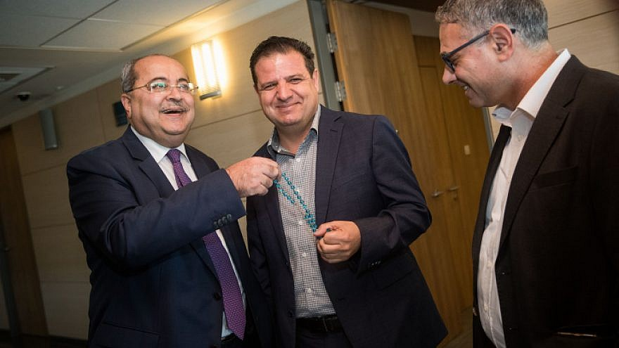 Leader of the Joint list Ayman Odeh (center) and party members Ahmad Tibi (left) and Mtanes Shehadeh arrive for a meeting with party members at the Knesset on Sept. 22, 2019, ahead of a meeting with the president, where they will give their recommendation for who with be given the mandate to build the next coalition following the elections. Photo by Yonatan Sindel/Flash90.