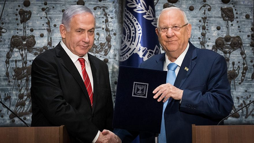Israeli President Reuven Rivlin presents Israeli Prime Minister Benjamin Netanyahu with the mandate to form a new government, after the results of the country's votes were announced following the Sept. 17 elections, at the President's Residence in Jerusalem on Sept. 25, 2019. Photo by Yonatan Sindel/Flash90.