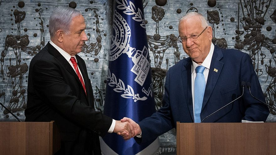 Israeli President Reuven Rivlin presents Israeli Prime Minister Benjamin Netanyahu with the mandate to form a new government following the Sept. 17 general elections that nearly repeated the April 9 results, at the President's Residence in Jerusalem, Sept. 25, 2019. Photo by Yonatan Sindel/Flash90.
