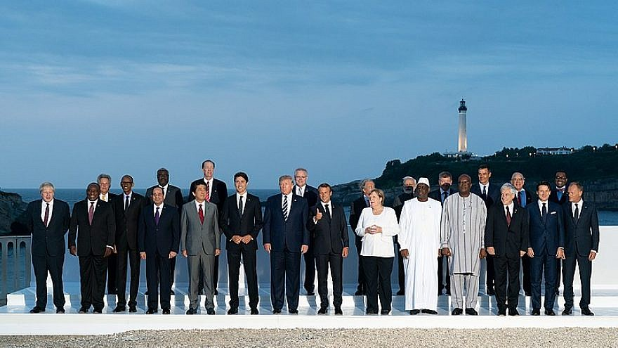 """U.S. President Donald Trump joins the G7 leadership and extended G7 members for the """"family photo"""" in Biarritz, France, on Aug. 25, 2019. Credit: Official White House Photo by Andrea Hanks."""