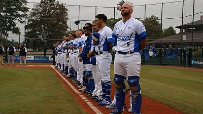 Players for Team Israel stand for the national anthem during a game in the European Championships. Photo by Margo Sugarman.