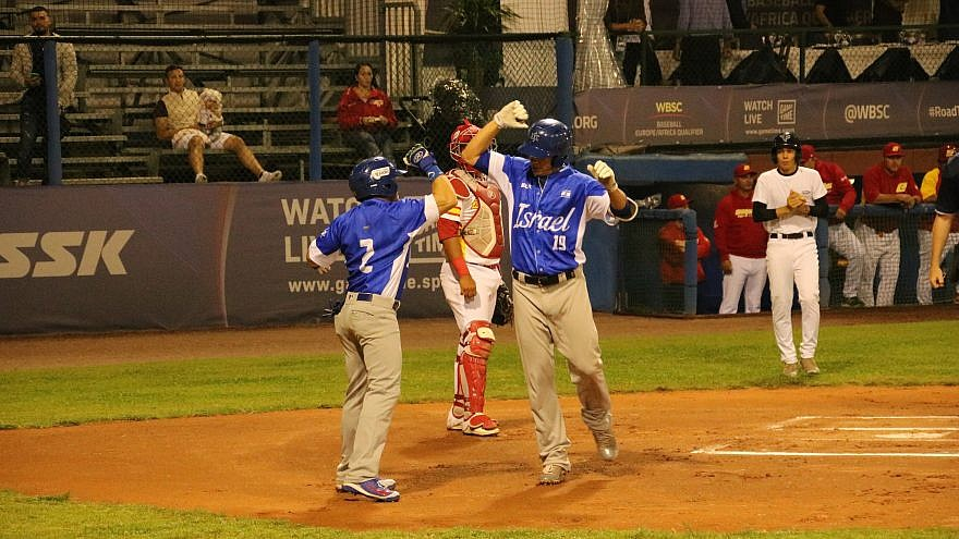 Team Israel celebrates scoring a run during a game against Spain. Photo by Margo Sugarman.