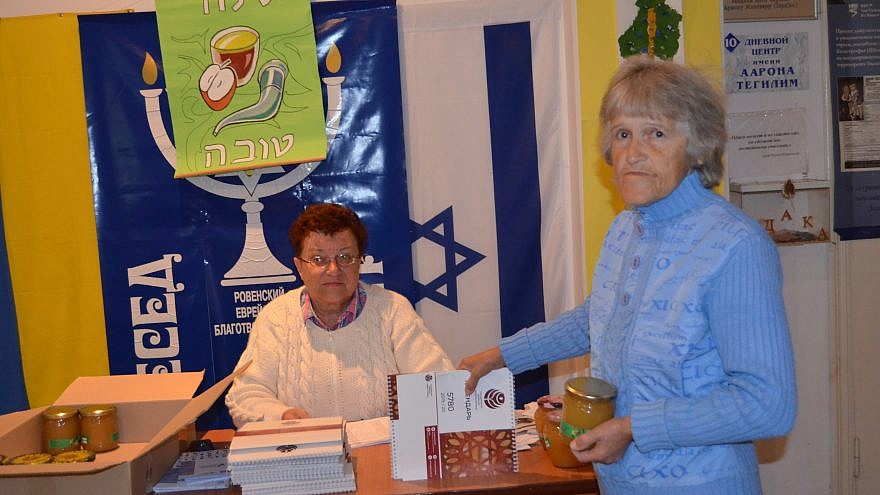 More than 8,500 poor, elderly Jews from in the former Soviet Union will receive a special holiday package of food and traditional holiday items for Rosh Hashanah, including honey, September 2016. Credit: JDC.