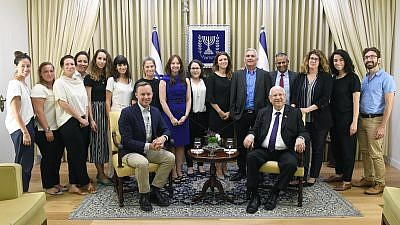 Israeli President Reuven Rivlin (seated at right) with innovation team members representing the Bloomberg Foundation and Peres Center for Peace. Credit: Mark Neiman/GPO.