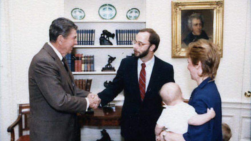 Charles Kupperman greets U.S. President Ronald Reagan in 1987. Credit: Wikipedia.