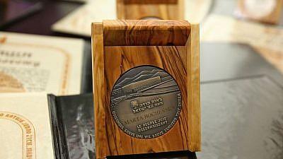 The Righteous Among the Nations medal received posthumously by Marta Bocheńska on April 17, 2012, in the Polish Senate. Credit: Michał Józefaciuk via Wikimedia Commons.
