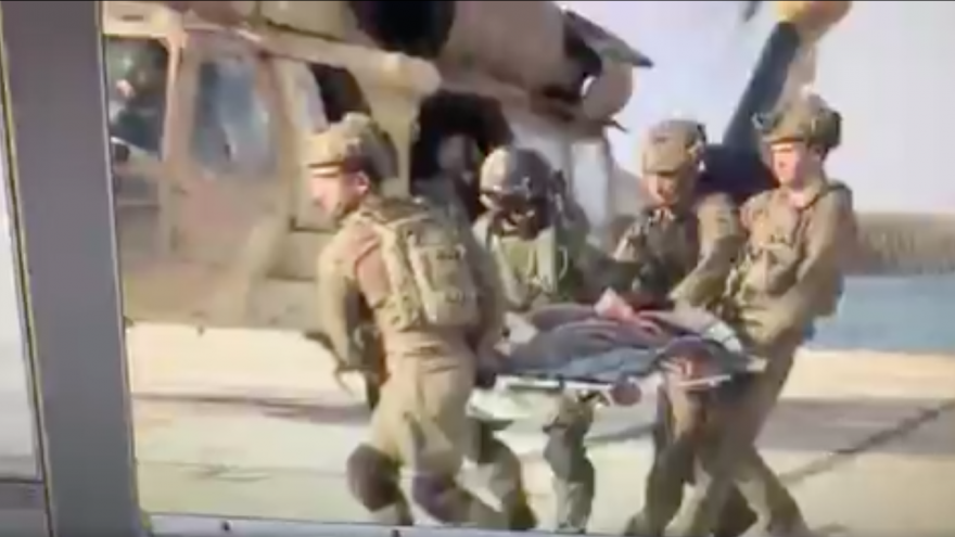 "A still image from a video broadcast by Israeli media shortly after a Hezbollah attack in northern Israel on Sept. 1, 2019. The video, which later turned out to have been faked by the Israeli military, shows a ""wounded Israeli soldier"" being evacuated by helicopter. Source: Screenshot."