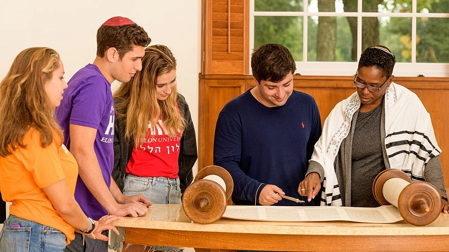 Students at Elon University in North Carolina read from the Torah. Credit:  Elon University Hillel.