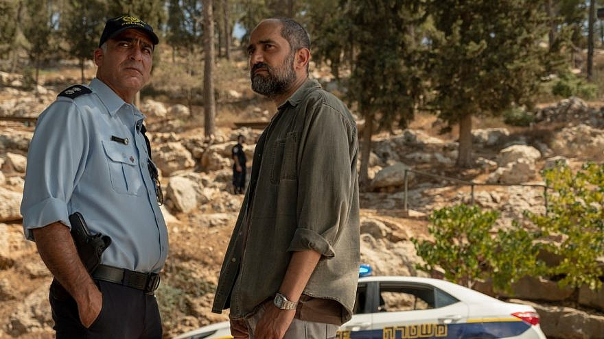 """A member of the Israeli police and a Shin Bet Israeli security officer stand next to each other in a scene in HBO's """"Our Boys."""" Credit: HBO."""