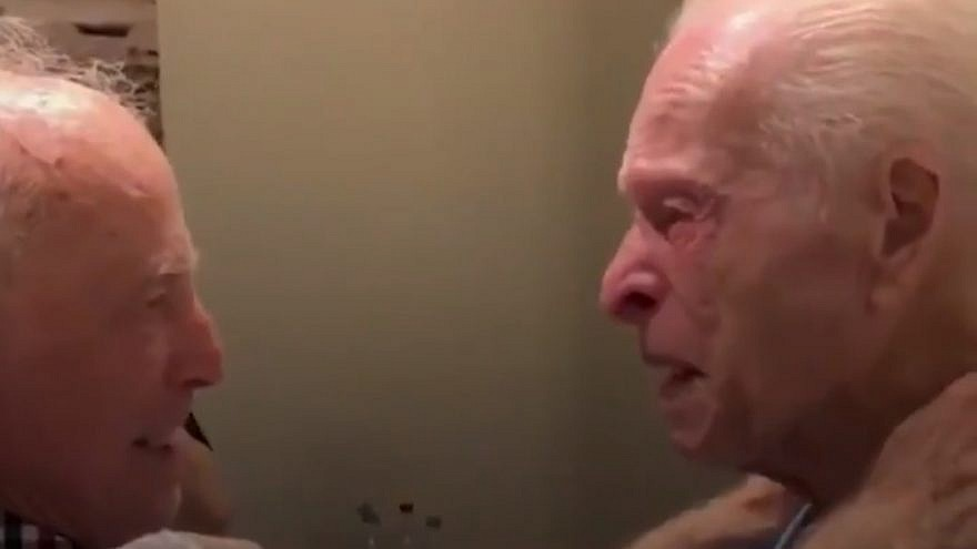Morris Sana, 87, and his cousin, Simon Mairowitz, 85, greet each other after 75 years of believing the other had perished in World War II. Credit: Screenshot.
