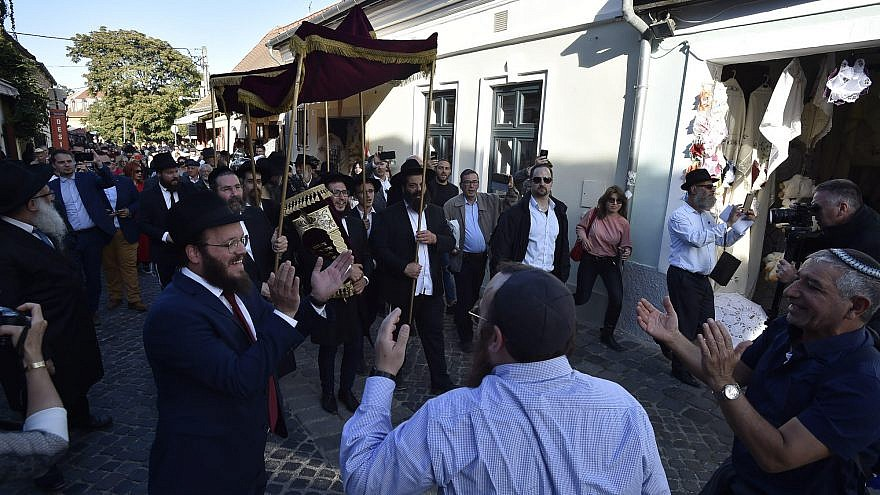 Rabbi Shlomo Koves (left) rejoices with the Budapest Jewish community as it celebrates two new Torah scrolls and synagogue openings in Hungary, on Sept. 22, 2019. Credit: Zsolt Demecs.