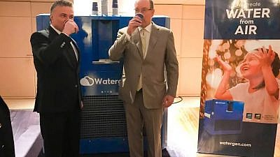 Monaco's Prince Albert II and Dr. Michael Mirilashvili drinking from Watergen's system. Credit: Watergen.