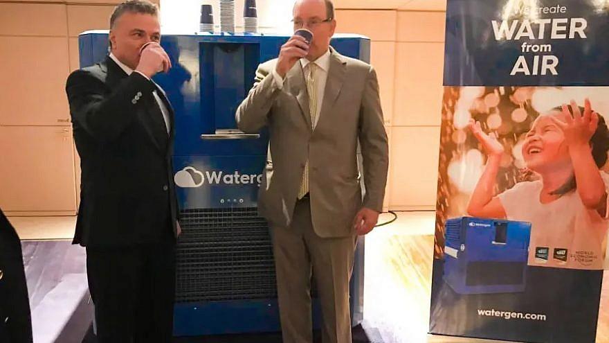 Monaco's Prince Albert II and Dr. Michael Mirilashvili drinking from Watergen's system. Credit: Watergen.