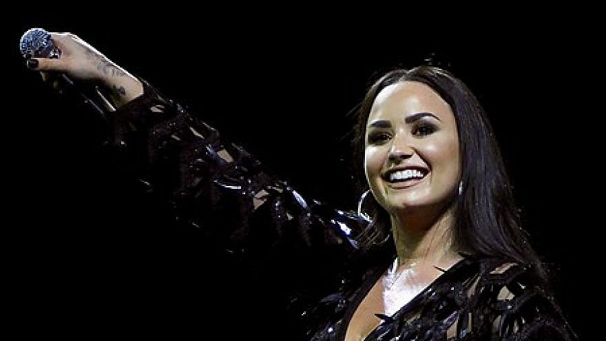 American pop singer Demi Lovato performs in Glasgow, Scotland, during her Tell Me You Love Me world tour, June 13, 2018. Credit: Wikimedia Commons.