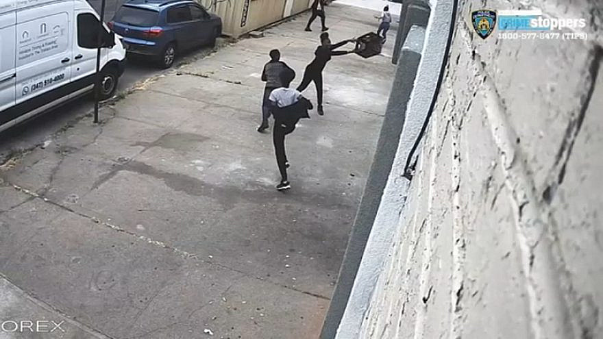A screenshot of NYPD security footage showing a milk crate being thrown at the windows of a synagogue in the Williamsburg neighborhood of Brooklyn, N.Y. Source: Screenshot.