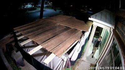 The sukkah at Michigan State University was destroyed during the holiday of Sukkot, as captured on surveillance video. Source: MSU Hillel/Facebook.