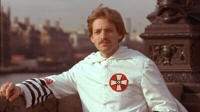 American neo-Nazi, anti-Semitic conspiracy theorist, Holocaust-denier and former Grand Wizard of the Ku Klux Klan David Duke outside the House of Parliament in London, 1978. Credit: Wikimedia Commons.