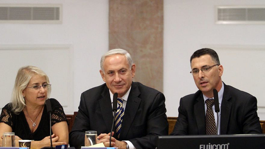 Israel's Prime Minister Benjamin Netanyahu (center) and Education Minister Gideon Sa'ar (right) attend a meeting in preparation for the opening of schools, on Aug. 26, 2012. Photo by  Yoav Ari Dudkevitch/Flash90.