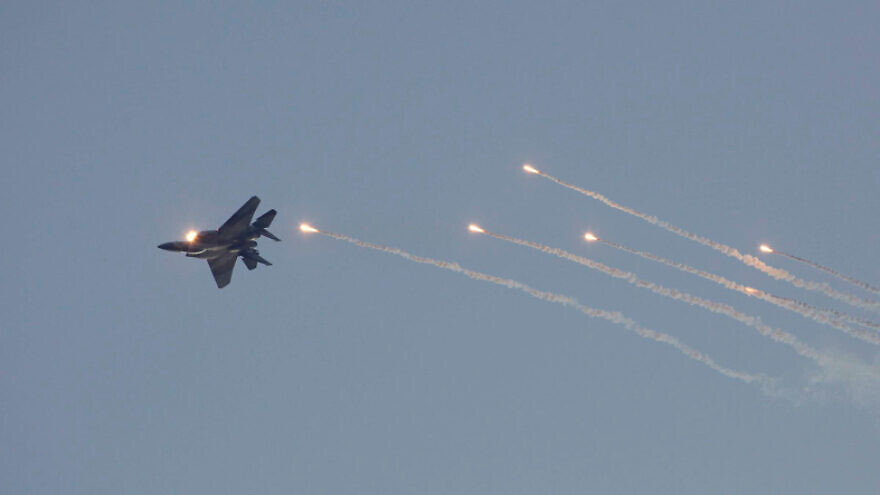An Israeli F-15I fighter jet releases flares during a graduation ceremony of new Israeli Air Force pilots at the Hatzerim Air Force base near the southern city of Beersheba, Dec. 27, 2012. Photo by Flash90.