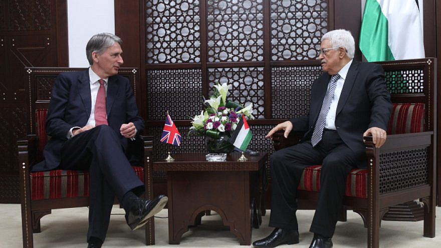 Palestinian Authority leader Mahmoud Abbas (right) meets with British Foreign Secretary Philip Hammond in the West Bank city of Ramallah on July 23, 2014. Photo by Issam Rimawi/Flash90.