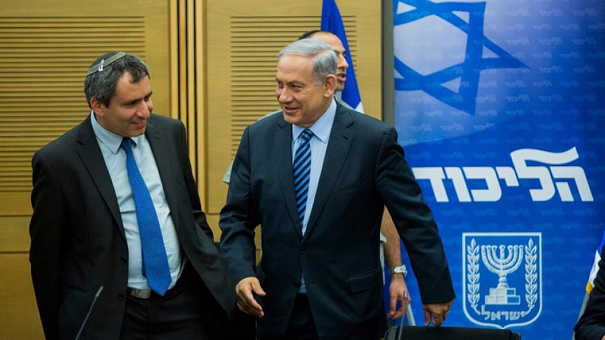 Israeli Prime Minister Benjamin Netanyahu speaks with Immigrant Absorption Minister Ze'ev Elkin during a Likud Party meeting at the Knesset, on May 18, 2015. Photo by Yonatan Sindel/Flash90.
