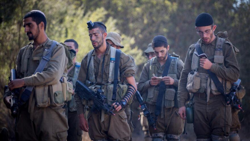 Religious Israeli soldiers pray near the city of Beit Shemesh, Sept. 27, 2017. Photo by Yonatan Sindel/Flash90.