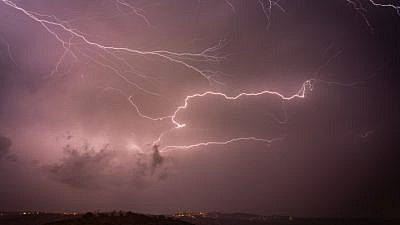 Illustrative: Lightning illuminates the sky over the Shomron Mountains in the West Bank on Nov. 4, 2018. Photo by Hillel Maeir/Flash90.