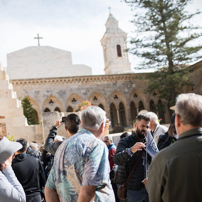 Tourists visit the Church of the Pater Noster, a Roman Catholic Church located on the Mount of Olives in Jerusalem, on Dec. 3, 2018. It is part of a Carmelite monastery, also known as the Sanctuary of the Eleona. Photo by Hadas Parush/Flash90.
