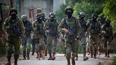 Illustrative: Israeli soldiers seen during a raid in the West Bank on March 17, 2019. Photo by Flash90.