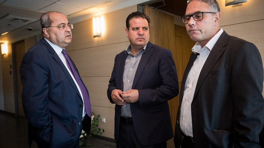 Joint Arab List leader Ayman Odeh (center) and party members Ahmad Tibi (left) and Mtanes Shehadeh arrive for a meeting at the Knesset on Sept. 22, 2019. Photo by Yonatan Sindel/Flash90.